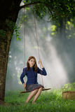 Beautiful girl plays swing royalty free stock photos