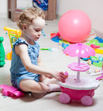 Beautiful girl plays toys Royalty Free Stock Images