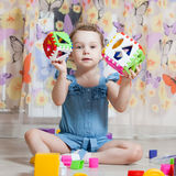 Beautiful girl plays toys Stock Images
