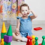 Beautiful girl plays toys Stock Photo