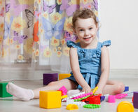 Beautiful girl plays toys Royalty Free Stock Image