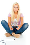 Girl playing video games on the joystick Royalty Free Stock Images