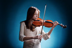 Beautiful girl plays on violin royalty free stock images
