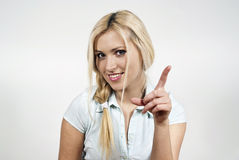 Beautiful girl pointed his finger at the top of. The background Stock Images
