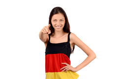 Beautiful girl pointing in front. Royalty Free Stock Photos