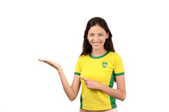 Beautiful girl pointing and showing. Royalty Free Stock Photography