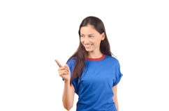 Beautiful girl pointing to the side. Royalty Free Stock Image