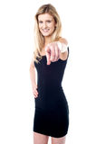Beautiful girl pointing towards you Stock Photography