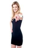 Beautiful girl pointing towards you Stock Photos