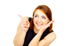 Beautiful girl points a finger Royalty Free Stock Image