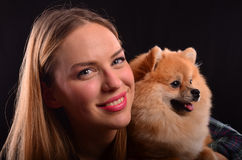 Beautiful girl and Pomeranian dog Stock Image