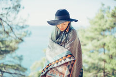 Beautiful girl in poncho outdoor royalty free stock image
