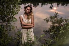 Beautiful girl in a pond Stock Photo