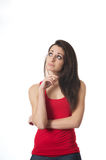 Beautiful girl pondering Stock Image