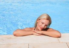 Beautiful girl in the pool Stock Photo