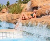 Beautiful girl in the pool Stock Image