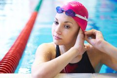 Beautiful girl at the pool stock photography