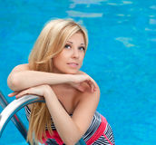 Beautiful girl in the pool Royalty Free Stock Photo