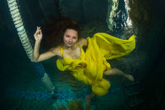 Beautiful girl in the pool. Royalty Free Stock Photography