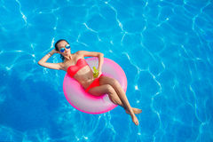 Beautiful girl in the pool on inflatable lifebuoy Royalty Free Stock Photo