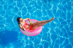 Beautiful girl in the pool on inflatable lifebuoy Royalty Free Stock Photography