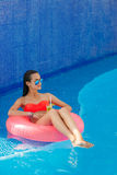 Beautiful girl in the pool on inflatable lifebuoy Stock Images