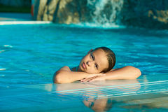Beautiful Girl in the pool. Beautiful Girl lying on the pool`s ledge Stock Images