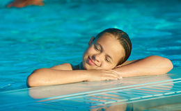 Beautiful Girl in the pool Stock Images