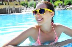 Beautiful girl in pool. Royalty Free Stock Photo
