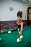Beautiful girl with the pool table Stock Images