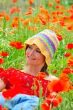 Beautiful girl with poppies. Beautiful girl on a field with poppies stock images