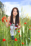 Beautiful girl in the poppy field, Royalty Free Stock Images
