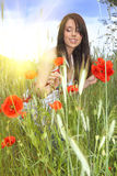 Beautiful girl in the poppy field. Stock Image