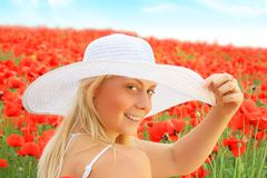 Beautiful girl in the poppy field Stock Images