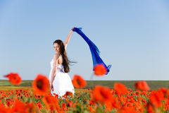 Beautiful girl in the poppy field Stock Image