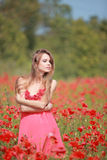 Beautiful Girl in the poppy field, red dress Royalty Free Stock Images