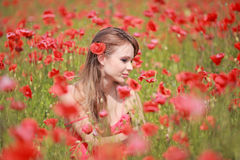 Beautiful Girl in the poppy field, red dress Royalty Free Stock Photos