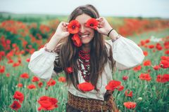 Beautiful girl in the poppy field. stock images