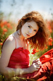 Beautiful girl in poppy field Stock Photo