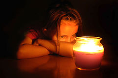 Beautiful Girl Portrait. Little beautiful girl portrait by warm candle light Royalty Free Stock Photo