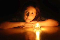 Beautiful Girl Portrait. Young beautiful girl portrait by glow of candlelight Royalty Free Stock Images