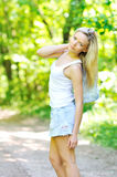 Beautiful girl portrait. Beautiful girl walking in a park royalty free stock photos