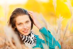 Beautiful girl portrait in autumn grass Stock Photography