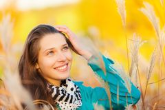 Beautiful girl portrait in autumn grass Stock Images