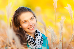 Beautiful girl portrait in autumn grass Royalty Free Stock Photography