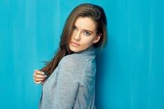 Beautiful girl portrait on blue. Wall background stock photo