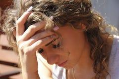 Beautiful girl portrait in depression. Headache royalty free stock photos