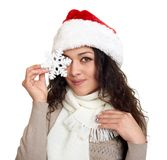 Beautiful girl portrait dressed in santa hat show big snowflake toy. White isolated background. New year eve and winter holiday co Royalty Free Stock Images