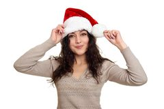 Beautiful girl portrait dressed in santa hat. White isolated background. New year eve and winter holiday concept. Royalty Free Stock Photo