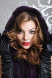 Beautiful girl portrait in fur coat. Sexy woman red lips leather gloves mink fur coat Stock Photos